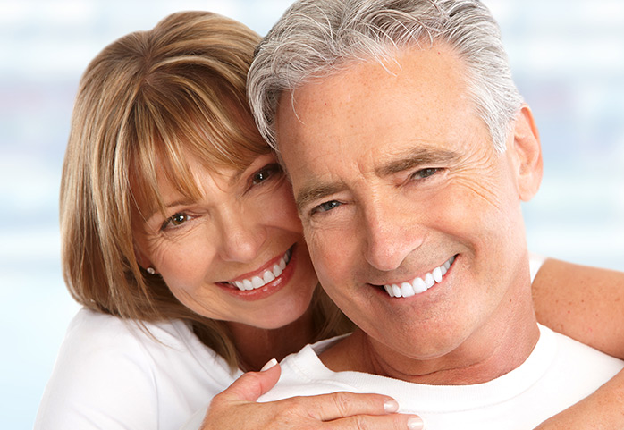 happy couple after dental implants in philadelphia pa area